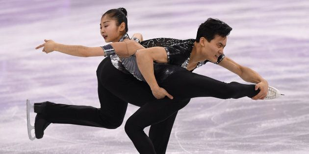 North Korea's Ryom Tae Ok and North Korea's Kim Ju Sik (R) compete in the pair skating short program...
