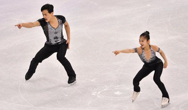 North Korea's Kim Ju Sik and North Korea's Ryom Tae Ok (R) compete in the pair skating short program...