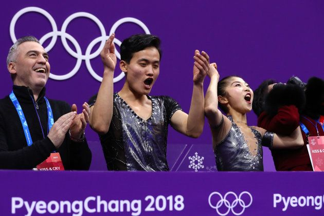 GANGNEUNG, SOUTH KOREA - FEBRUARY 14: Tae Ok Ryom and Ju Sik Kim of North Korea react after receiving...