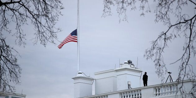 WASHINGTON, DC - FEBRUARY 15: The American flag above the White House is lowered to half staff following...