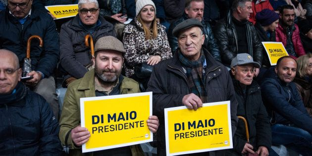 POMIGLIANO D'ARCO, ITALY - FEBRUARY 12: Supporters of the Five Star Movement hold up signs reading 'Di...