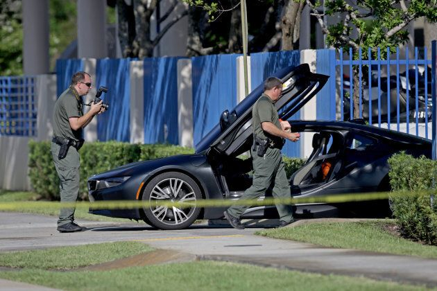 A BMW sits idle after reports of a shooting in Deerfield Beach involving Broward rapper XXXTentacion...