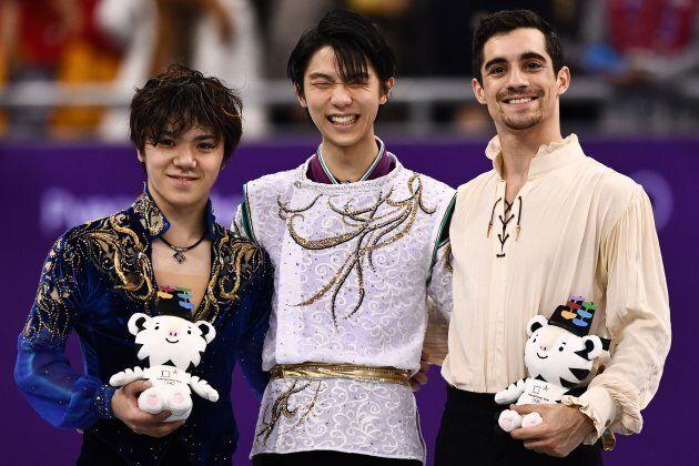 TOPSHOT - (L-R) Silver medallist Japan's Shoma Uno, gold medallist Japan's Yuzuru Hanyu and bronze medallist...