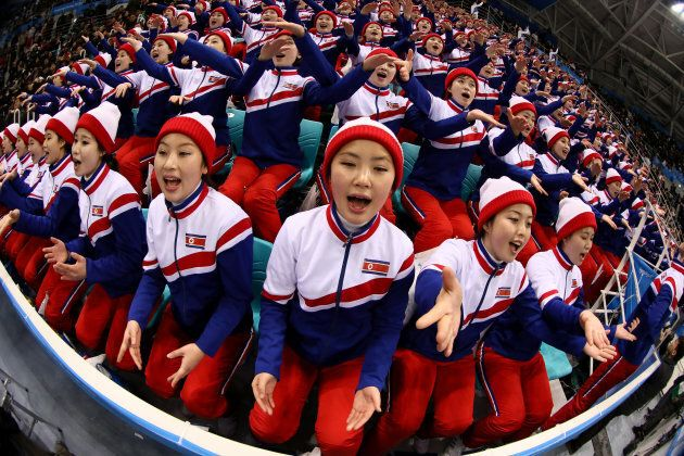 GANGNEUNG, SOUTH KOREA - FEBRUARY 15: North Korean cheerleaders sing during the Men's Ice Hockey Preliminary...