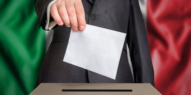 Election in Italy - voting at the ballot box. The hand of man putting his vote in the ballot box. Flag...