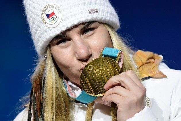 TOPSHOT - Czech Republic's gold medallist Ester Ledecka kisses her medal on the podium during the medal...