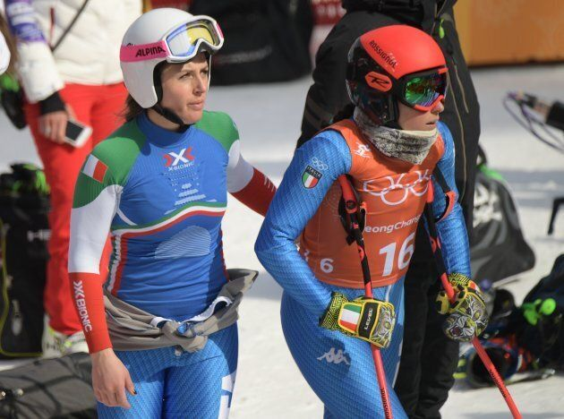 Italy's Sofia Goggia (R) and Italy's Nadia Fanchini stand together after crossing the finish line of...