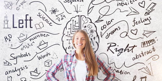 Cheerful young girl on concrete background with creative sketch. Different brain sides