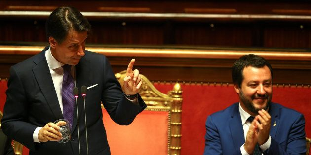 Newly appointed Italian Prime Minister Giuseppe Conte gestures next to Interior Minister Matteo Salvini...