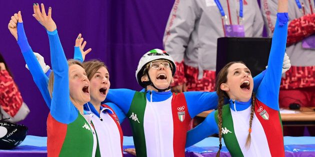 Italy's skaters celebrate winning the silver medal in the women's 3,000m relay short track speed skating...