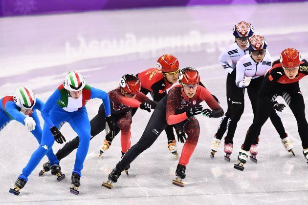 Athletes hand-off in the women's 3,000m relay short track speed skating A final event during the Pyeongchang...