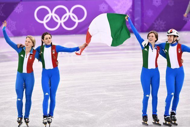 The Italian team celebrate their silver in the women's 3,000m relay short track speed skating A final...