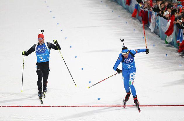 PYEONGCHANG-GUN, SOUTH KOREA - FEBRUARY 20: Dominik Windisch of Italy crosses the finish line ahead of...