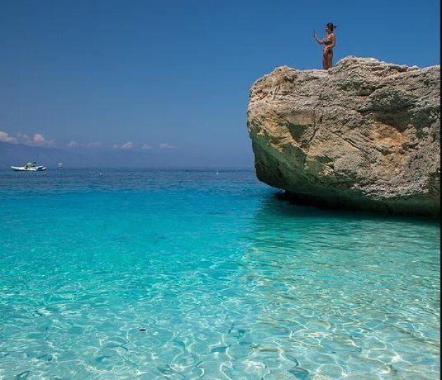 Crystalline water and fish in Cala Mariolu beach, Baunei, Ogliastra province, Sardinia, Italy,