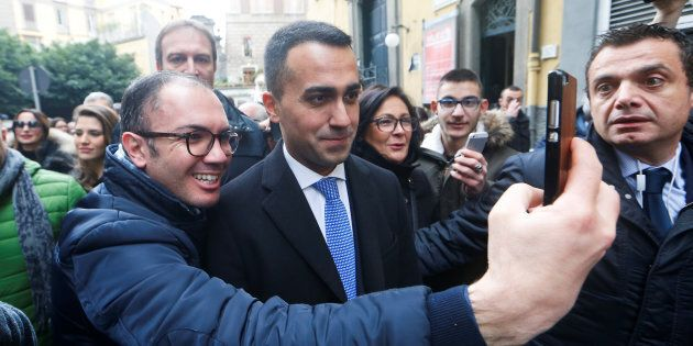 5-Star Movement leader Luigi Di Maio poses for a selfie as he arrives to attend a political rally in...