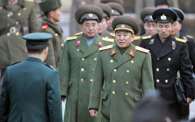 North Korea's chief delegate Kim Yong Chol (2nd R) and other military officers are greeted by a South...