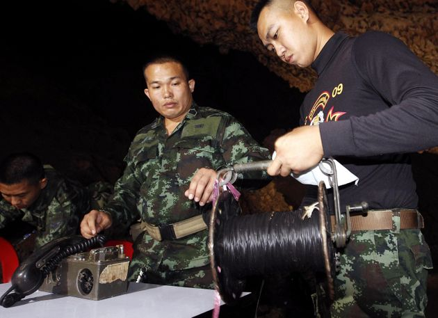 epa06840439 Thai military officials prepared a communications area during a rescue operation for missing...