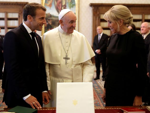 Pope Francis exchanges gifts with French President Emmanuel Macron and his wife Brigitte during a private...