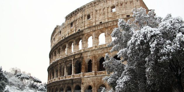 The Coliseum covered by snow, a really rare event in Rome. FOTO DI