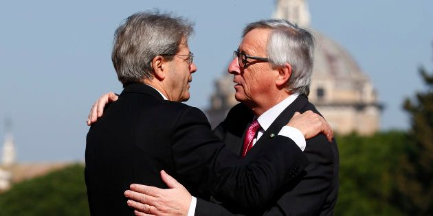 European Commission President Jean-Claude Juncker is welcomed by Italy's Prime Minister Paolo Gentiloni...