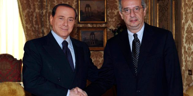 Italy's Prime Minister Silvio Berlusconi (L) shakes hand with centre-left opposition leader Walter Veltroni...