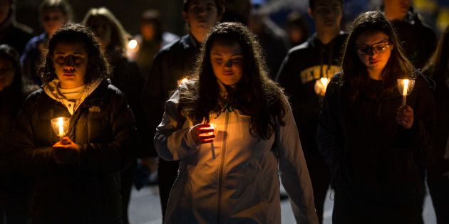 NEWTOWN, CT - FEBRUARY 23: Led by high school students, mourners walk around the track of the football...
