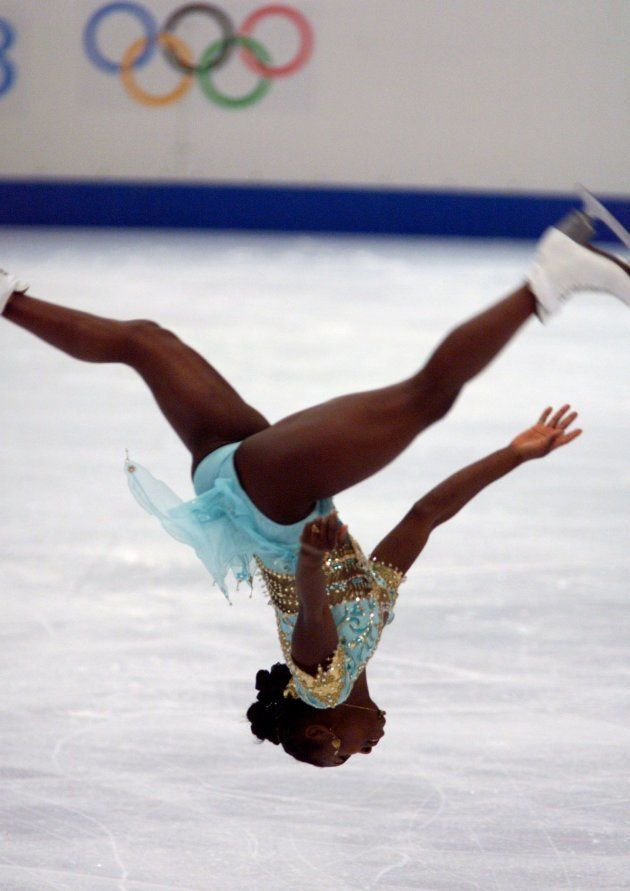 Surya Bonaly performs a backward somersault during her performance in the women's free programme figure...