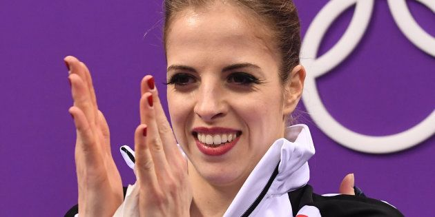 Italy's Carolina Kostner reacts after the women's single skating free skating of the figure skating event...