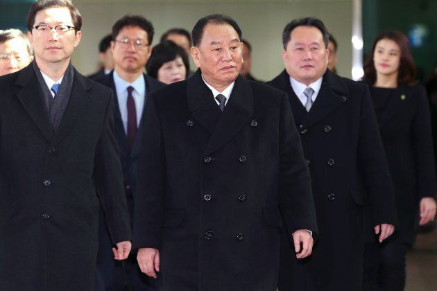 TOPSHOT - Kim Yong Chol (C), who leads a North Korean high-level delegation to attend the Pyeongchang...