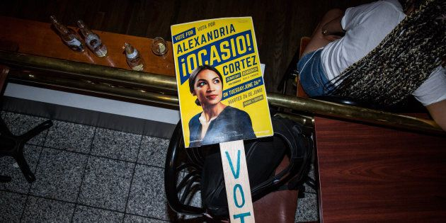NEW YORK, NY - JUNE 26: A sign for progressive challenger Alexandria Ocasio-Cortez at her victory party...
