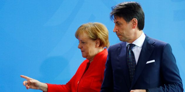 German Chancellor Angela Merkel and Italian Prime Minister Giuseppe Conte leave after a news conference...