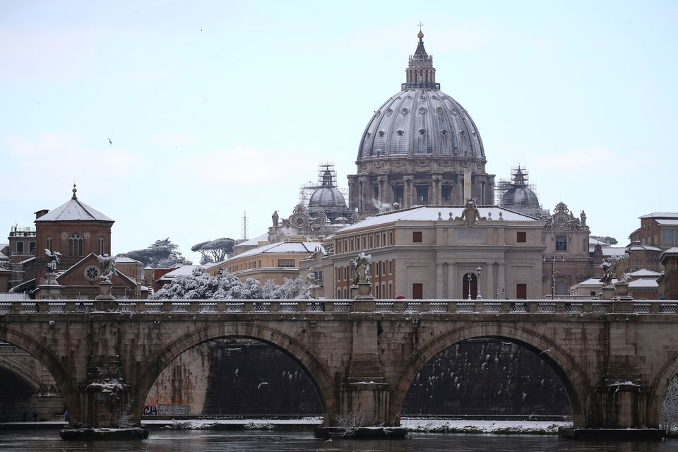Saint Peter's Basilica dome is seen during a heavy snowfall in Rome, Italy February 26, 2018. REUTERS/Alessandro