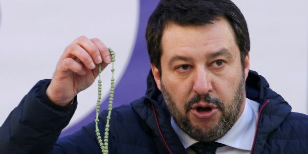 Italian Northern League leader Matteo Salvini shows a rosary as he speaks during a political rally in...