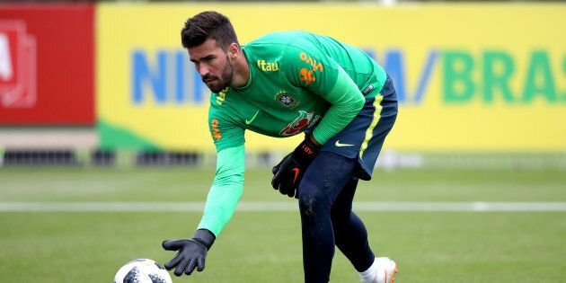 Brazil's Allison Becker during the training session at Enfield Training Ground, London. (Photo by John...
