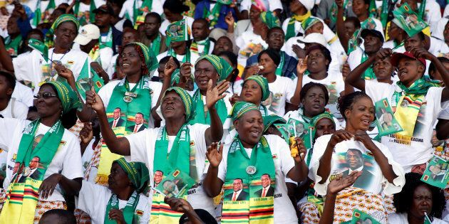 Crowds of supporters await the arrival President Emmerson Mnangagwa at an election rally in Hwange, Zimbabwe,...