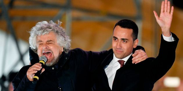 Italy's populist Five Star Movement (M5S) founder Beppe Grillo and M5s leader Luigi Di Maio (R) hug at...