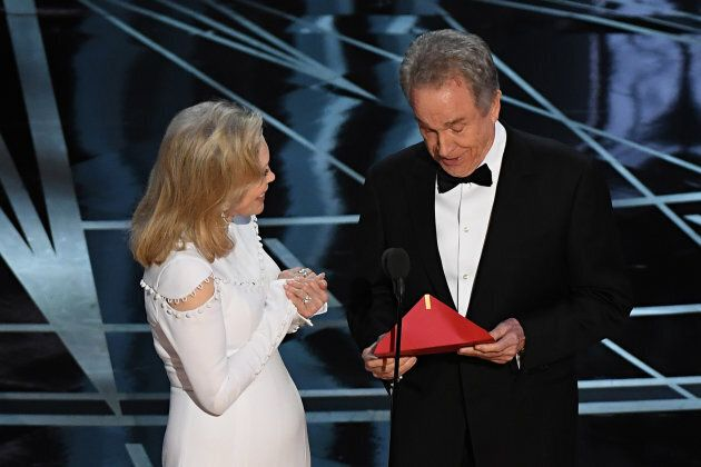 Actress Faye Dunaway and actor Warren Beatty arrive on stage to announce the winner of the Best Movie...