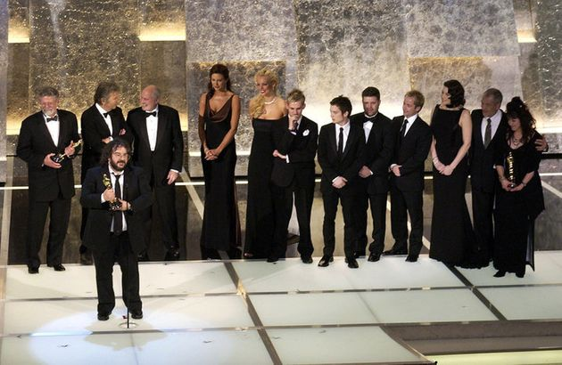 Peter Jackson with the cast and producers as he accepts his award for Best Picture for