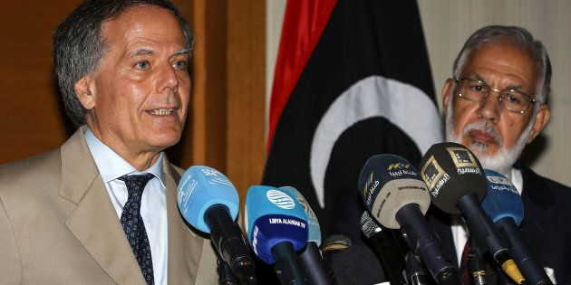 Italian Foreign Minister Enzo Moavero Milanesi (L) speaks during a press conference with his Libyan unity...