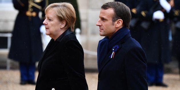 PARIS, FRANCE - NOVEMBER 11: French President Emmanuel Macron (R) and German Chancellor Angela Merkel...