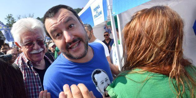 Italian 'Lega Nord' party leader Matteo Salvini greets supporters as he arrives at the yearly meeting...