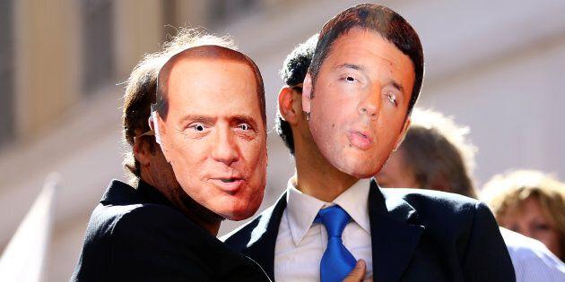 5-Star Movement supporters wear masks depicting former Italian Prime Ministers Silvio Berlusconi (L)...