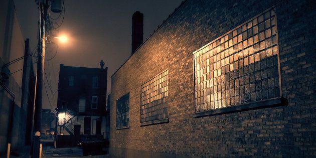 Dark urban city alley at