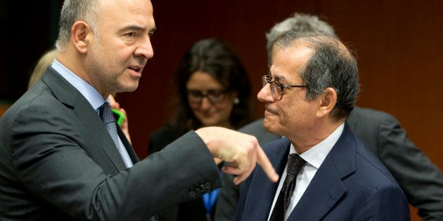 European Commissioner for Economic and Financial Affairs Pierre Moscovici, left, speaks with Italian...