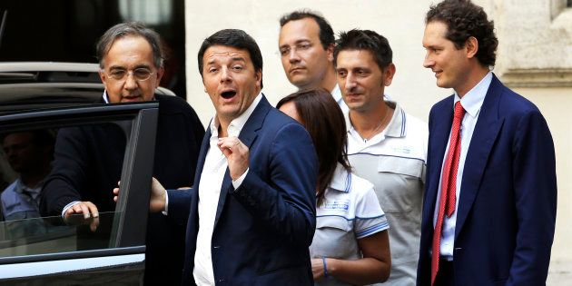 Italian Prime Minister Matteo Renzi (2nd L) gestures during a meeting with Fiat Chairman John Elkann...