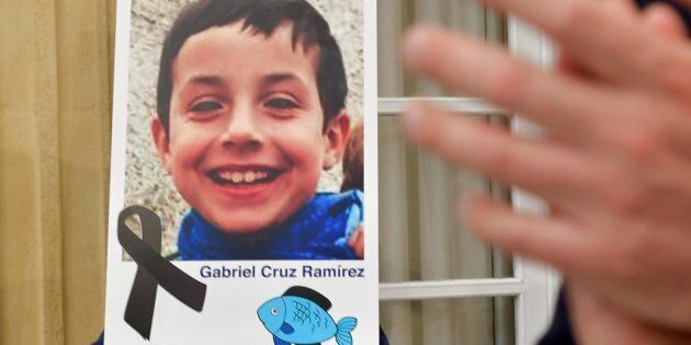 epa06597816 A photograph of young Gabriel Cruz is seen with a black ribbon as a sign of respect at the...