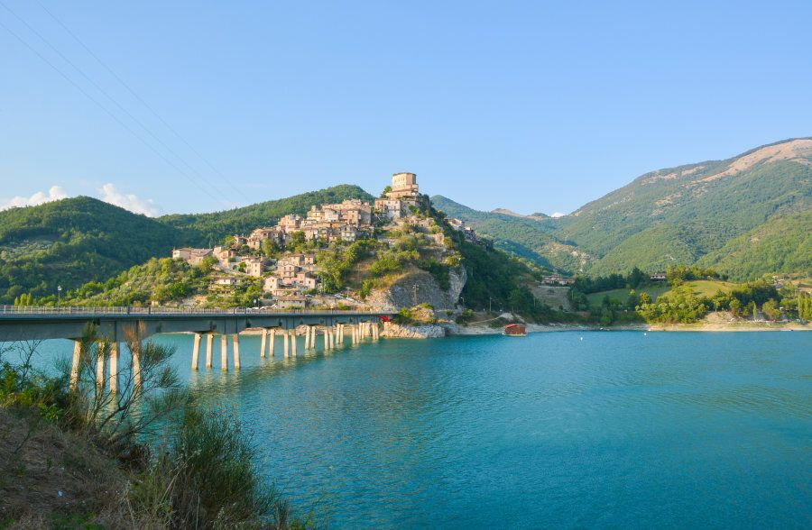 Turano lake in province of Rieti, central Italy, with the town of Castel di