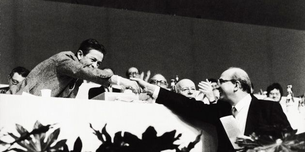 The General Secretary of the Italian Communist Party Enrico Berlinguer shaking hands with the socialist...