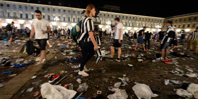 Juventus supporters look for personal belongings at Piazza San Carlo after a panic movement in the fanzone...