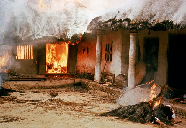 Houses burned by American soldiers during the My Lai massacre on March 16, 1968 in My Lai, South Vietnam....